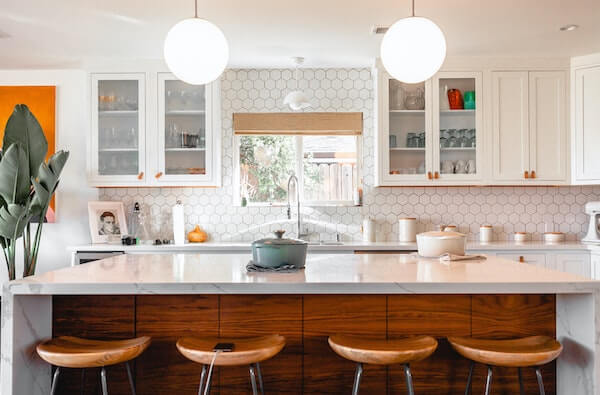 four brown stools in a white kitchen