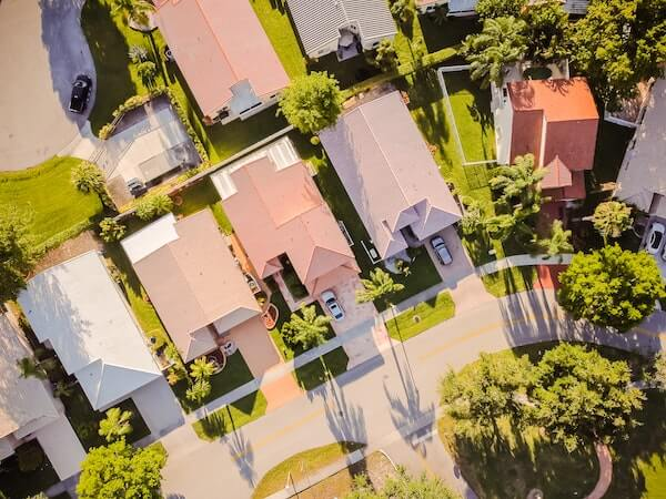 aerial view of suburban homes and green trees
