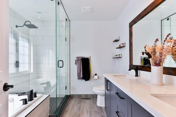 modern bathroom with a stand-alone shower, bathtub, and white sink